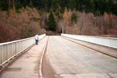 Elderly man walking over bridge Royalty Free Stock Image