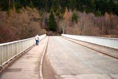 Elderly man walking over bridge Royalty Free Stock Image