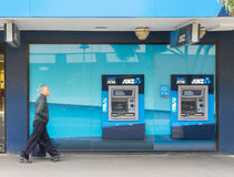 Elderly man walking pass the ANZ bank Stock Images