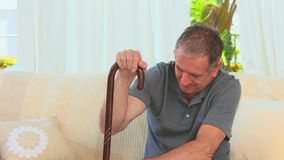 Elderly man with a walking stick stock footage