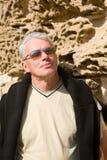 Elderly man at wall. Grey-haired man at the ancient wall Royalty Free Stock Image