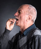 Elderly man wants to take a pill Royalty Free Stock Photo