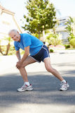 Elderly man warming up for run Royalty Free Stock Photo