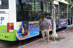Elderly man washing bus Royalty Free Stock Photo