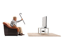 Elderly man watching football on TV and cheering. Ecstatic elderly man watching football on TV and cheering isolated on white background Stock Photo