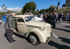 Elderly man watching retro car on exhibition of vintage auto in Tbilisi Royalty Free Stock Images