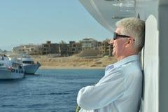 Elderly man watching sea Stock Image