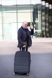 Elderly man waving goodbye Royalty Free Stock Image