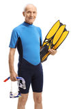 Elderly man in a wetsuit with snorkeling equipment Stock Image