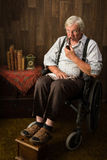 Elderly man in wheelchair Royalty Free Stock Images