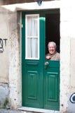 Elderly man in the window Stock Photo
