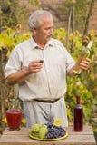 Elderly Man With Wine Stock Photo