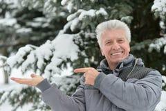 Elderly man in winter  pointing Royalty Free Stock Photos