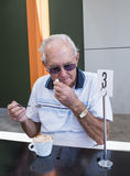 Elderly Man Wiping His Mouth. Stock Photos