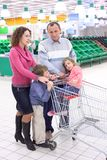 Elderly man and woman with children in shop Royalty Free Stock Photo