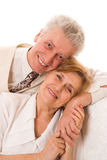 Elderly man and woman  at each other white Stock Images