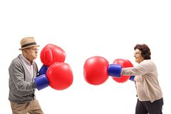 Elderly man and an elderly woman fighting each other with big bo stock photo