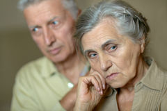Elderly man and woman with flu Stock Images