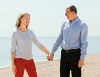 Elderly man and woman are holding hands Stock Photo