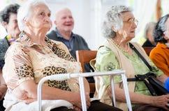 Elderly man and woman. Elderly men and women sitting royalty free stock image