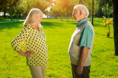 Elderly man and woman outdoors. Stock Photo