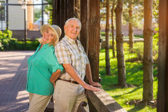 Elderly man and woman smiling. stock photo