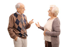 Elderly man and woman talking. Elderly men and women talking to each other isolated on white background Stock Image