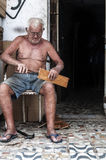 Elderly man working in the street Royalty Free Stock Photo