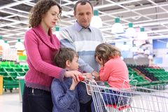Elderly man and young woman with children in shop Stock Image