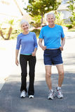 Elderly man and younger woman jogging Stock Photo
