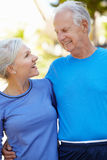 Elderly man and younger woman outdoors Royalty Free Stock Images