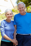Elderly man and younger woman outdoors Royalty Free Stock Photos