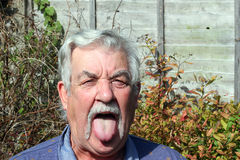 Elderly mans tongue. Royalty Free Stock Photos