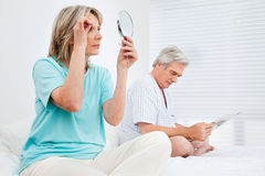 Elderly married couple in bedroom Stock Photography