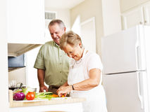 Elderly married couple cooking dinner Stock Image