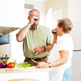 Elderly married couple drinking a toast Royalty Free Stock Photo
