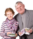 Elderly married couple with money in hands Stock Photo