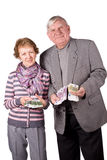 Elderly married couple with money in hands royalty free stock photo