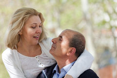 Elderly married couple staying in park Stock Images