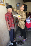 Elderly medical treatment. Elderly is receiving medical treatment in a hall in the city of Solo, Central Java, Indonesia stock image