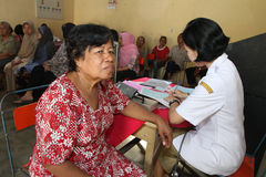 Elderly medical treatment. Elderly is receiving medical treatment in a hall in the city of Solo, Central Java, Indonesia royalty free stock image