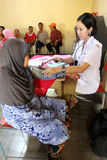 Elderly medical treatment. Elderly is receiving medical treatment in a hall in the city of Solo, Central Java, Indonesia royalty free stock images