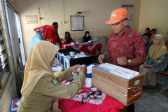 Elderly medical treatment. Elderly is receiving medical treatment in a hall in the city of Solo, Central Java, Indonesia stock photography