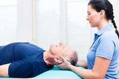 Senior man visiting physiotherapist for massage. Elderly men getting massage from physio Stock Photography