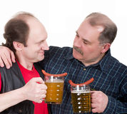 Elderly men holding a beer belly. And sausage Stock Images