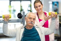 Elderly man lifting dumbbells Royalty Free Stock Photo