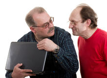 Elderly  men with notebook Royalty Free Stock Photos