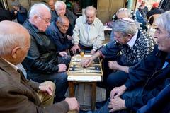 Elderly men play backgammon in Jerusalem, Israel stock photo