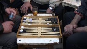 Elderly men play backgammon in Mahane Yehuda Market in Jerusalem, Israel stock video