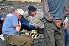 Elderly men playing chess. In Barselona stock photo